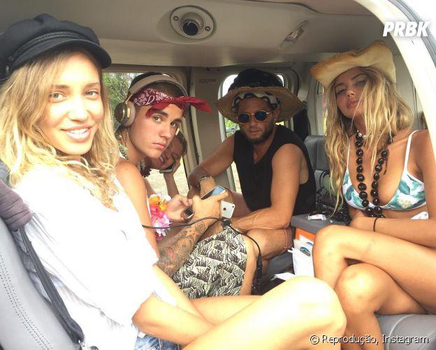 Justin Bieber aparece com modelos durante viagem ao Havaí!