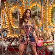 A cantora Anitta compartilhou com seus seguidores do Facebook algumas fotos de ensaio fotográfico em parque de diversões