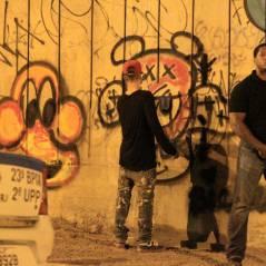 Justin Bieber grafita muro e briga com fotógrafos no Rio de Janeiro