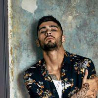 Zayn Malik, ex-One Direction, mostra admiração pela boy band e tem parede de casa só para o grupo!