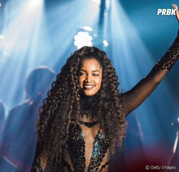 Iza irá se apresentar no Palco Mundo do Rock in Rio 2022 depois de assistir o festival no gramado em 2011. Relembre sua trajetória!